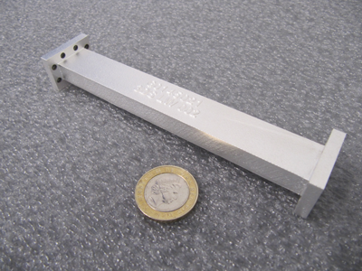 The 3D printed RF filter designed by Airbus Defence and Space consolidates two parts into one and reduces overall mass. 3D printing enables faster production and lower costs.